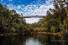 Suspended (southernspiritnr84) Tags: blue abandoned road bridge river water sky damage nsw maldon australia