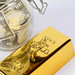 Gold bar with glass jar full of money