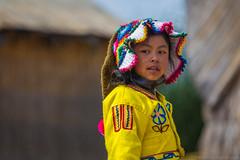 The Child of Uros (Andrea Gambadoro) Tags: yellow child children portrait beauty folk folklore costume photography photographer street pros island peru south american andrea gambadoro travel