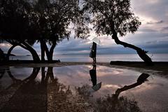 Rainy day (Artemios Karavas) Tags: artemiosphotos attica sky sea seaside reflections girl greece photography person urban waterfront water clouds trees rain top20greece