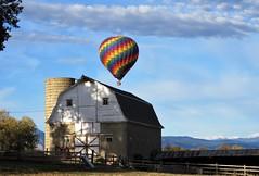 The Ascent (Patricia Henschen) Tags: erie colorado clouds balloon hotair barn ranch mountain mountains frontrange autumn