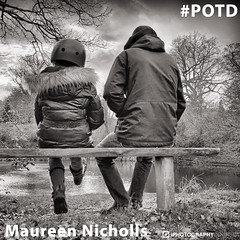 Maureen Nicholls POTD (iPhotographyCourse) Tags: bnw black white monochrome father son child parent bench lake water cold winter hats helmet bike jacket coat time parenting family soul countryside outdoors together love happiness moment candid legs feet photography photographytutorial photographer photoshop photomanipulation potd photo photographygame photographycompetition photographyblog portraits photographyclass onlinelearing photographytips photocourse tips hints ideas online onlinephotography onlineclass