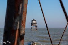 Through the legs (Dan Elms Photography) Tags: dovercourt dovercourtessex lighthouse sea coastal essex coast seaside beach england canon 5d 100mm macro macrolens rust rusty
