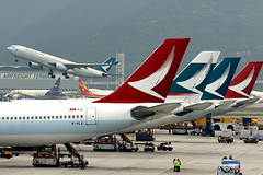 Density... (Manuel Negrerie) Tags: bhle cx ka cathaypacific cathaydragon airlines tails design logo graphic airliners travel sight moment spotting canon photography flying airport hkg impression a330 airbusa330 airbus colors wings