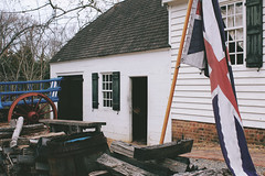 Flag (danicalees) Tags: williamsburg virginia colonial march 2013 overcast cloudy trees flag exterior building winter