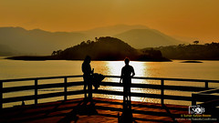 I N D U C T I O N (Suman Kalyan Biswas) Tags: silhouette landscape portrait umiamlake meghalaya shillong afternoon hills nature outdoor streetphotography orange lightandshadow shadow light love attachment beautifulnature india