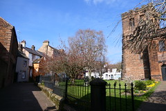 St. Andrew's Churchyard (Ian R. Simpson) Tags: cottages houses buildings tree path footpath railings fence architecture standrewschurch standrewschurchyard penrith cumbria england standrews church churchofengland anglican cofe trees tower graveyard graves