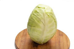 Whole raw cabbage on the wooden board (wuestenigel) Tags: close foliage cabbage dieting greenstuff space background salad vegetarian isolated white single eating woodenboard whole closeup nobody vitamin food one head healthy ingredient diet nature whitebackground borecole cut studio bright raw leaf garden health green fresh photo vegetable organic