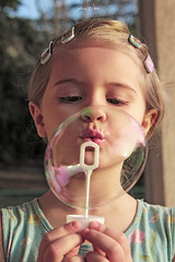 Let's blow it up! (alice.nanni) Tags: girl kid kiddo blondekid blondehair soft bubbles soapbubble playing blowing soap kidplaying canon canonphotos canonphotography canoneos2000d warm outdoors bambina kidportrait portrait ritratto