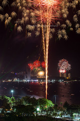 Pattaya's Countdown 2019 Fireworks. (baddoguy) Tags: 2019 arts culture entertainment awe beach party brightly lit celebration ceremony chonburi province city color image countdown exploding firework display flash focus on foreground happiness hope concept international landmark joy landscape scenery light effect local long exposure majestic midnight multi colored national new years eve night no people orange outdoors social event pattaya photography red sign sky taking off activity thailand urban skyline vertical vibrant yellow