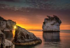 Rughe prima del make up (Gio_guarda_le_stelle) Tags: sunrise sescape sea water sunbeams reflection seaside italy mattina quiete roccia atmosphere waves gold alba aurora