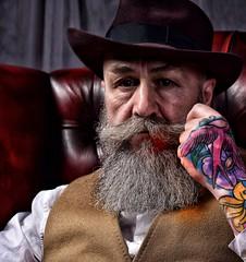 Pip #2 (Mr_Pudd) Tags: whiteshirt leatherchair chair shirt hat greybeard beard tattoo nikkor nikon85mmf14 nikond750 nikon pip studio