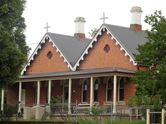 Tumut. The convent building which was part of the Catholic School. Built 1886 with very decorative barge boards on the gables. (denisbin) Tags: tumut bank commercialbankofsydney bankofnewsouthwales italianate presbytery catholicpresbytery convent catholicschool gable bargeboards
