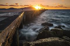 Only one will remain. (Emykla) Tags: mare sea cielo sky bacoli napoli italia italy nikon3100 campiflegrei light waves onde yellow giallo pontile pier