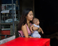 Motherhood (Beegee49) Tags: street woman mother holding baby filipina content happy planet luminar sony a6000 bacolod city philippines asia
