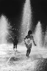 Jugando en el Agua (matiasrquiroga) Tags: children playing water fun black white blanco y negro monochrome monocromo vertical park cordoba argentina niños niñes kids siblings