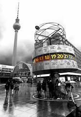 Alexanderplatz (Anthony Mark Images) Tags: berlin germany deutschland cloudy raining reflections peoplewalking people dog umbrella monochrome blackandwhite selectivecolour alexanderplatz berlinerfurnsehturm tvtower mitte trainstation flickrclickx nikon d850 jasonbourne movielocations thebournesupremacy