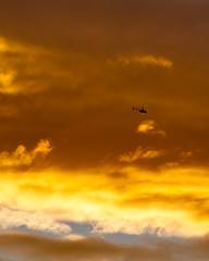 Subcloud Copter Near Sunset (eanwe) Tags: cloud helicopter light sky sunlight