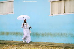 Dark in White....! (elbigote1946) Tags: umbrellaandmore white dark fashion caribbean