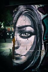 brick wall (Al Fed) Tags: 20181111 athen athens greece graffiti woman bricks wall incomplete half portrait eye sad