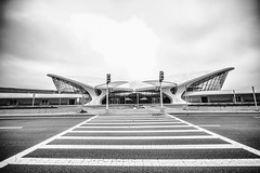 His New Future Without Her in It (Thomas Hawk) Tags: america eerosaarinen futurist googie jfk johnfkennedyairport neofuturist newyork newyorkcity twaflightcenter transworldflightcenter usa unitedstates unitedstatesofamerica airport architecture bw fav10 fav25 fav50 fav100