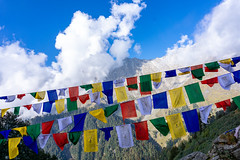Snow Line and Flags (Anderson Porfírio - Fotografia) Tags: azul bluesky clouds dharamsala india flags tibetanflags prayerflags mountain mountains snowmountain hiking landscape landscapes colorful