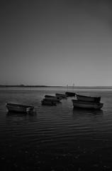 Boats at high tide (sam.naylor) Tags: uk hayling island sussex chichester britain sea seaside coast pentax dslr digital 28mm black white monochrome sun warm contrast