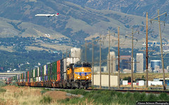 Underneath the Radar (jamesbelmont) Tags: unionpacific zg1ci saltlakecity utah train railroad railway delta jet airline powerpoles airport