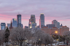 Sunset over Minneapolis Skyline (Sam Wagner Photography) Tags: pink skyline sky sunset colorful magic golden hour telephoto close up downtown minneapolis minnesota midwest twin cities skyscrapers architecture cloudy spring