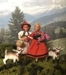 Sisters (Foxy Belle) Tags: doll caco miniature mountain goat outside diorama plants bavarian german traditional folk clothing costume green red white family children schleich kid bell 118