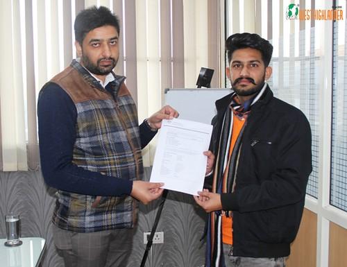 Mr. Gurvinder Kang (Director of West Highlander) handing over Australia Student Visa to Gurveer Singh