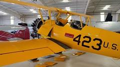 In the shop - Boeing/Stearman A75N1 VN2S Kaydet, 1943 - U.S. Navy WWII biplane basic trainer. (edk7) Tags: nikond3200 edk7 2013 us usa arizona maricopacounty mesa falconfieldairport kffz commemorativeairforce caf arizonawingaviationmuseum unitedstatesnavy usnavy usn boeingstearmana75n1vn2skaydet pt17 sn754894 1943 n52558 military biplane basictrainer aircraft aviation plane airplane warplane secondworldwar worldwartwo worldwarii worldwar2 wwii ww2 opencockpit strut wire lycomingr6804pb4ninecylinderradial220hp cockpit hangar
