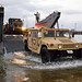 Drives a Humvee off a landing craft during a simulated Humanitarian Assistance-Disaster Relief mission