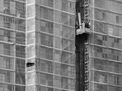 framework (heinzkren) Tags: wien vienna gerüst building lift men schwarzweis blackandwhite bw sw monochrome geometry panasonic lumix street streetphotography urban architecture skyscraper job site lines construction work worker arbeiter baustelle elevator
