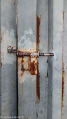 Rusty Misfit (lorinleecary) Tags: corrugatediron lock rust morrobay