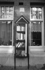 Public Library (Arne Kuilman) Tags: amsterdam nikon fm3a vivitar 28mm luckyshd iso100 id11 7minutes homedeveloped stock analogue film public library bibliotheek buurtboekenkast books boeken reading