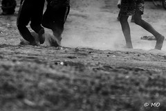 Dust and legs (mathieuo1) Tags: vietnam taynguyen asia raw art fineart people silhouette dark monochrome bnw fine artistic light dust play sand footbal kids bahnar travel explore graphic work nikon colorless shadow shape sharp abstract expression rules traveler dynamic mathieuo