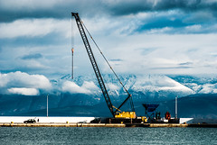 Weather changes moods (jimiliop) Tags: clouds sea sky mountains derrick port machinery yellow geometry kiato greece highcontrast morning winter