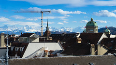 A city with a background (jaeschol) Tags: europa europe kantonbern kontinent schweiz stadtbern suisse switzerland wolken clouds parlament altstadt old town alps alpen schnee baukran kran crane