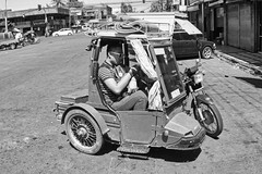 Tight Fit (Beegee49) Tags: motorbike sidecar tricycle street tall man blackandwhite monochrome bw panasonic fz1000 happy planet bacolod city luminar philippines asia happyplanet asiafavorites