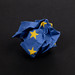 Screwed up European Union flag on black background