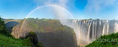 Victoria falls with rainbow (Denis Roschlau Photography) Tags: victoriafalls falls zambia sambia gorge schlucht wasserfall viktoriafälle afrika africa simbabwe zimbabwe rainbow regenbogen spray gischt landschaft landscape panorama nature natur