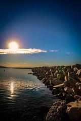 SoCal. Sunrise (jax.warren.27) Tags: light blue sky ocean sun depth angles perception reflection rock harbor calm morning sunrise cloud lines horizon vignette ray crop