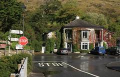 Keane's Bar (RoystonVasey) Tags: canon eos m 1855mm stm zoom republic ireland eire county galway road trip maum east keanes bar maam bridge pub inn sign stop rain puddle