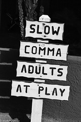 Slow Comma Adults At Play (Thad Zajdowicz) Tags: zajdowicz california usa travel canon eos 5dmarkiii dslr digital availablelight lightroom ef24105mmf4lisusm borregosprings sign humor grammaroutdoor outside words text writing letters