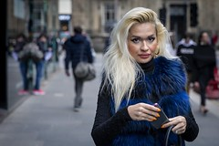 Made Up (Leanne Boulton) Tags: urban street candid portrait portraiture streetphotography candidstreetphotography candidportrait streetportrait eyecontact candideyecontact streetlife woman female girl face eyes expression mood emotion feeling makeup blonde blue fur furry fashion style tone texture detail depthoffield bokeh naturallight outdoor light shade city scene human life living humanity society culture lifestyle people canon canon5dmkiii 70mm ef2470mmf28liiusm color colour glasgow scotland uk