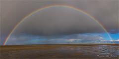 Chasing rainbows! (karindebruin) Tags: annemarie oesterdam tholen zeeland clouds hightide lowtide water wolken rainbow regenboog