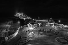 Cromer Pier B&W (John Joslin) Tags: cromer pier norfolk england sea ocean waves travel holiday monochrome wall architecture lights lamps streetlamps steps boardwalk promenade night dark evening