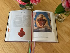 The Book Of Symbols, purchased used, had five colored ribbon bookmarks. Wondering if the ribbons marked a previous reader's trail, i checked the red ribbon.....i found The Heart....midway of the volume too