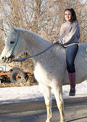 Pretty Girl On A  Horse (wyojones) Tags: wyoming bighorncounty cowley bighornbasin sky girl woman horse street bareback riding horseback boots gray white brunette beautiful lovely cute ponytail smile wyojones